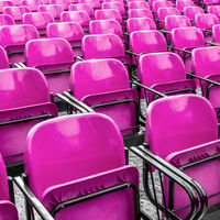Empty plastic pink chairs