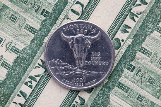 Symmetric composition of US dollar bills and a quarter of Montana