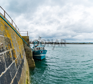 fishing boat anchored in the harbor of Saint Vaast la Hougue in Normandy