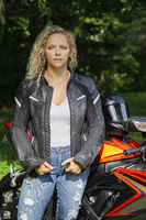 Serious biker in leather jacket