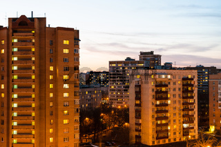 residential houses in city in spring evening
