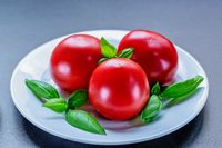 tomatoes and basil on plate. Food concept. Healthy and wholesome food