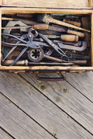 Box with different old hand tools