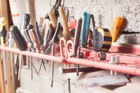 Carpenter tools fixed on the wall at workshop