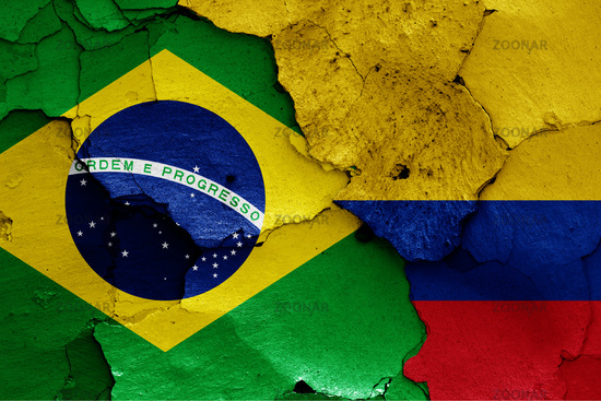 flags of Brazil and Colombia painted on cracked wall