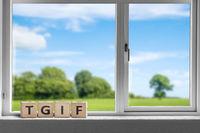 TGIF weekend sign in a white window