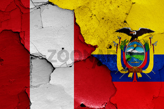 flags of Peru and Ecuador painted on cracked wall