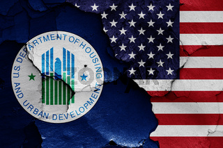 flags of Department of Housing and Urban Development and USA painted on cracked wall