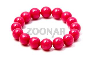 Pink plastic beaded bracelet
