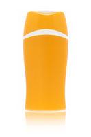 A blank orange sun cream bottle isolated on white background with fading reflection