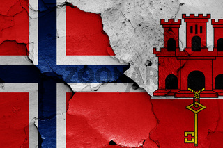 flags of Norway and Gibraltar painted on cracked wall