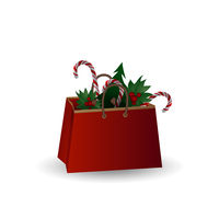 Festive composition with Christmas tree branches and sweets in a gift bag on a white background.