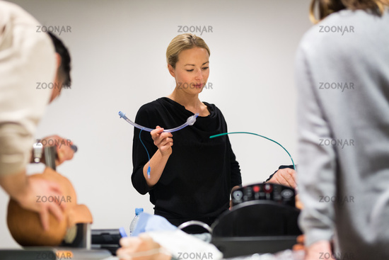 Medical doctor specialist expert displaying method of patient intubation technique on hands on medical education training and workshop