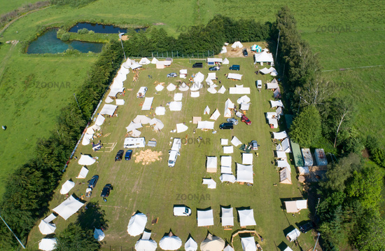 Aerial view of a tent camp and market stalls at a medieval spectacle
