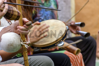 Berimbau and others instruments player during presentation of Brazilian capoeira