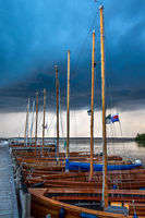 Amazing summer evening landscape with group of drifting yachts on a lake.