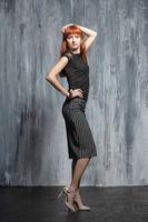Young pretty redhead lady posing in studio