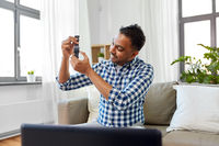 male blogger recording video review of smart watch
