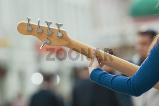 Female hands of street musician playing guitar