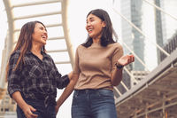 Multicultural Asian girlfriends having social time together on city holiday vacation - Best friends socialising while walking in urban environment