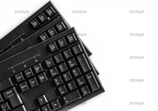 Three computer keyboards