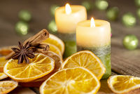 Christmas or advent decoration - orange slices, spices and candles