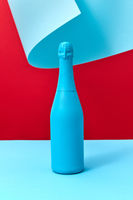 Painted blue mock-up bottle of wine on a duotone curly background.