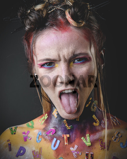 Young girl with creative alphabet makeup