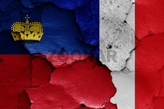 flags of Liechtenstein and France painted on cracked wall