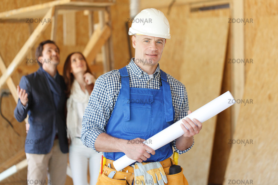 Foreman with house plans