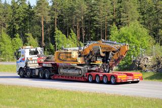 Sisu Truck Hauls Large Tracked Excavator