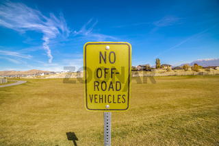 Road sign on a grassy field - No Off-road vehicles