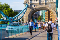 Tourists are walkng over Tower Bridge, London, UK