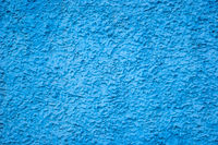 Texture of concrete wall with decorative plaster - photo. Color is blue.