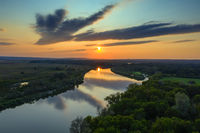 sunrise or sunset with forest and river