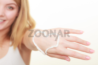 Cream on woman hand, heart shape