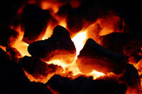 Bright embers made of wood in a fireplace