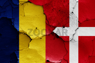 flags of Romania and Denmark painted on cracked wall