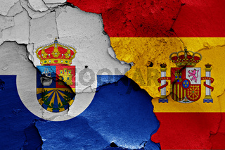 flags of Fuenlabrada and Spain painted on cracked wall