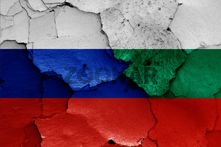 flags of Russia and Bulgaria painted on cracked wall