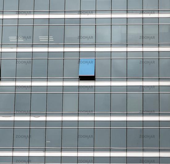 The glass facade of skyscraper