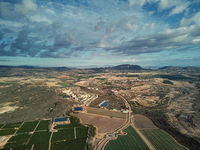 Aerial photography drone point of view region Murcia, countryside area, agricultural fields and meadows, cloudy sky. Spain