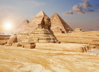 Famous Giza Sphinx and the Pyramids on the background, Egyptian desert