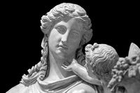 Marble head sculpture of young woman, ancient Greek goddess art bust statue isolated on black background