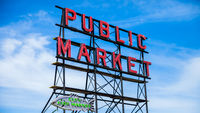 SEATTLE, WASHINGTON, USA - JULY 4, 2014: The iconic Seattle Public Market sign against a nice blue sky