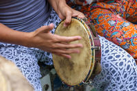 Woman's hands playing tambourine