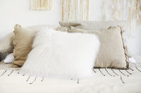 Interior of bedroom with bed in boho style decor macrame