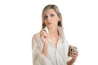 girl eating chocolate paste isolated on white background
