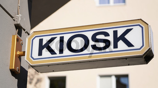 kiosk sign on building exterior