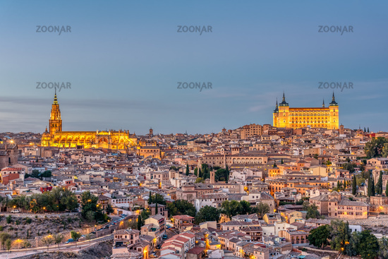 The old city of Toledo in Spain with the Cathedral and the Alcazar at dusk